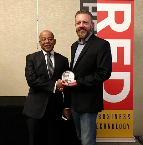 Jeffrey Finch, co-founder and CPO of Choozle, accepts the company's 2016 Red Herring Top 100 North America Award.