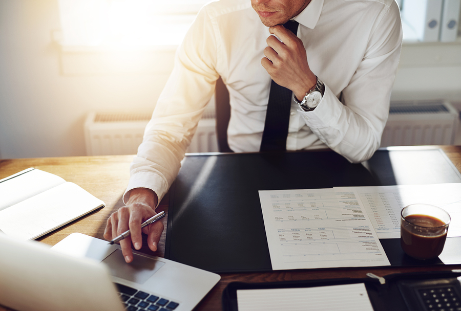bigstock-Business-Man-Working-At-Office-106691141