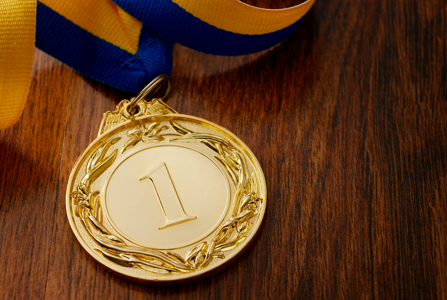 bigstock-Gold-Medal-On-A-Wooden-Table-80548214