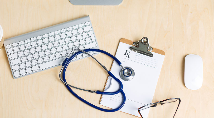 bigstock-Medicine-Doctor-s-Working-Tabl-95721890