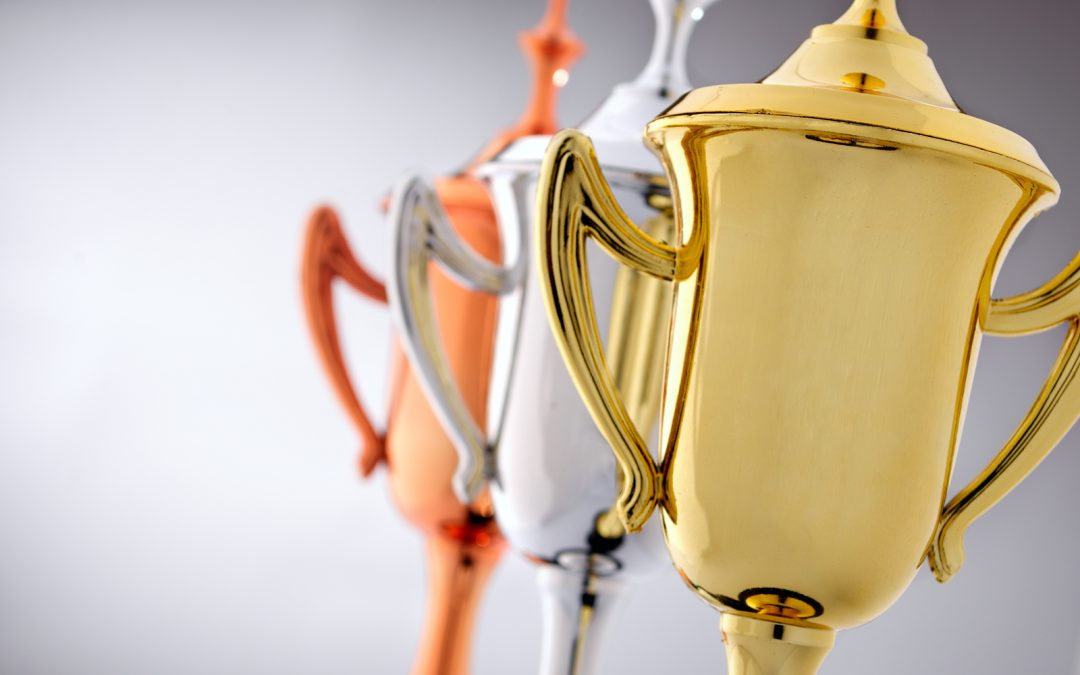 bigstock-Three-Trophy-Cups-In-Gold-Sil-87786350-1080x675