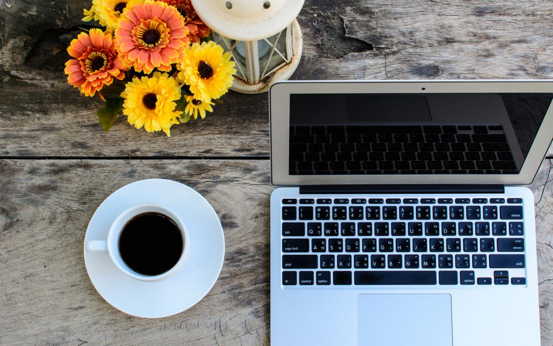 bigstock-Coffee-Laptop-On-Wooden-Table-65890372-1080x675